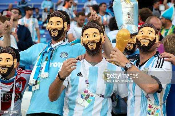 Argentina supporters wearing Lionel Messi masks enjoy the atmosphere prior to the 2018 FIFA World Cup Russia Group D match between Argentina and...