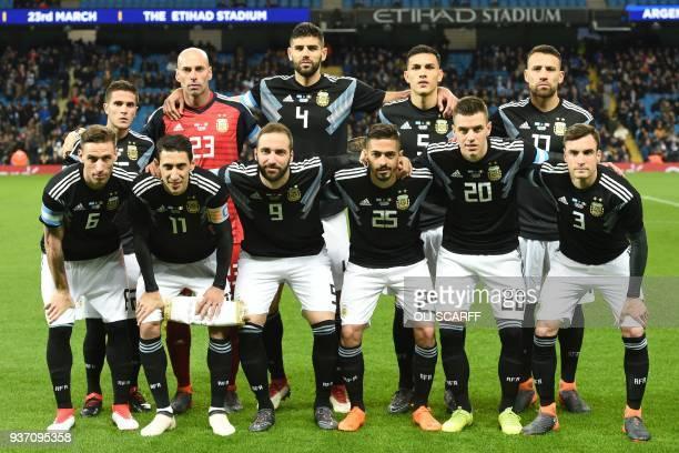 Argentina team Argentina's defender Fabricio Bustos Argentina's goalkeeper Willy Caballero Argentina's defender Federico Fazio Argentina's midfielder...
