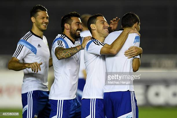 Argentina teammates Martin Demichelis Gonzalo Higuain and Maxi Rodriguez share a joke with Angel di Maria during the Argentina training session ahead...
