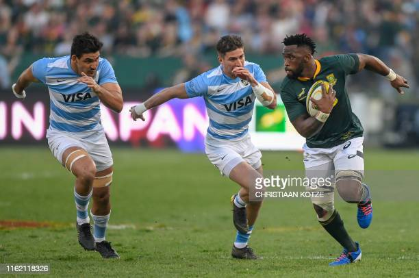 Argentina wing Sebastian Cancelliere prepares to tackle South Africa flanker Siya Kolisi during their 2019 Rugby Union World Cup warmup test match...