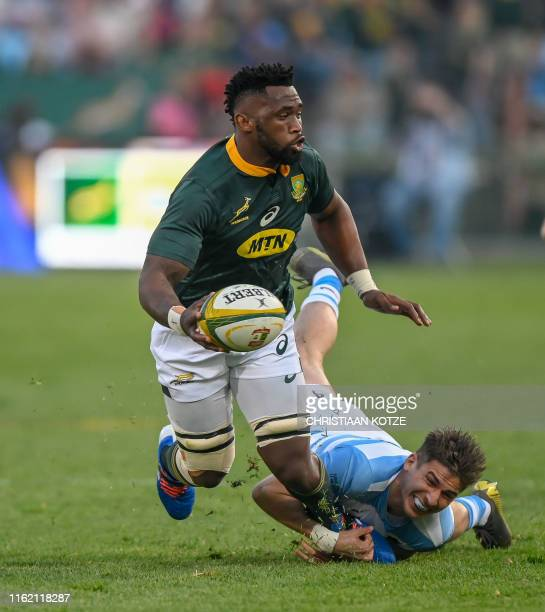 Argentina wing Sebastian Cancelliere tackles South Africa flanker Siya Kolisi during their 2019 Rugby Union World Cup warmup test match between South...