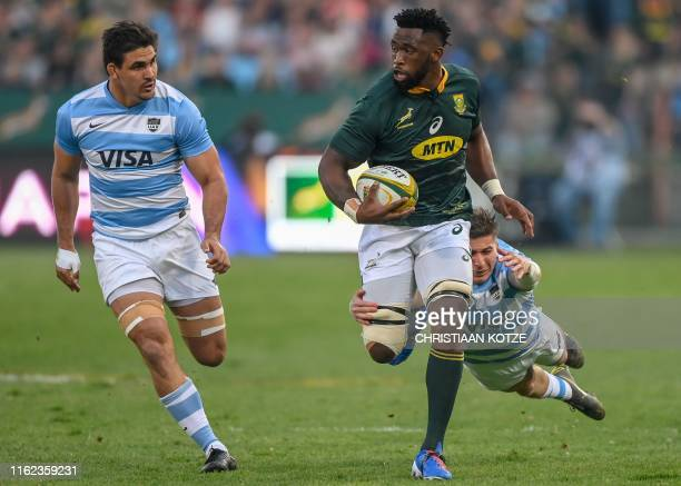 Argentina wing Sebastian Cancelliere tackles South Africa flanker Siya Kolisi during the 2019 Rugby Union World Cup warmup test match between South...