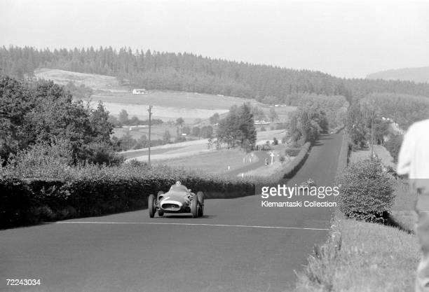 Argentinain racing driver Fangio in the lead before his planned pit stop to change tyres during the German Grand Prix Nurburgring 4th August 1957...