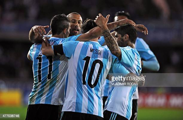 Argentinan football team player Sergio Aguero celebrates with teammates after scoring against Paraguay in the Copa America football match in La...