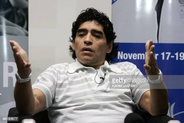 Argentina's 1986 World Cup winning hero Diego Maradona gives a press conference in Doha 17 November 2005 Football legends Pele and Maradona were...
