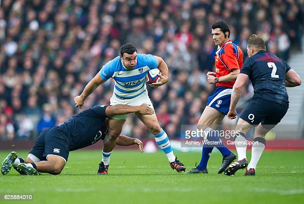 Argentina's Agustin Creevy is tackled by England's Mako Vunipola during the International match between England and Argentina at Twickenham Stadium...