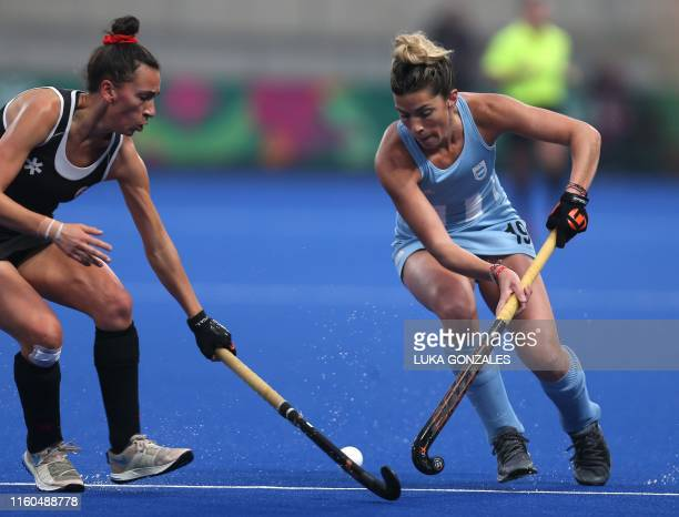 Argentina's Agustina Albertario dribbles past Canada's Sara McManus during the Lima 2019 PanAmerican Games Women's Gold Medal Field Hockey Match...