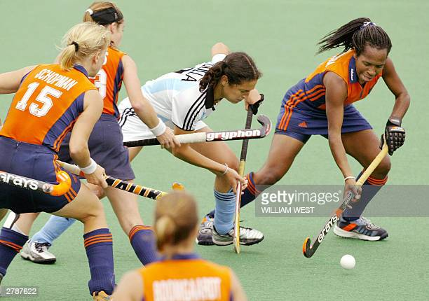 Argentina's Alejandra Gulla attempts to steer the ball past Maartje Scheepstra of the Netherlands in their Womens' Champions Trophy match played in...