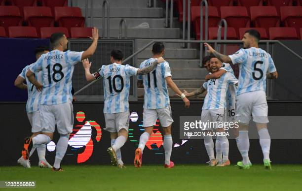 Argentina's Alejandro Gomez celebrates with teammates after scoring against Paraguay during their Conmebol Copa America 2021 football tournament...