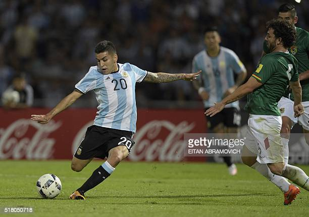 Argentina's Angel Correa and Bolivia's Fernando Marteli vie for the ball during the Russia 2018 FIFA World Cup South American Qualifiers' football...