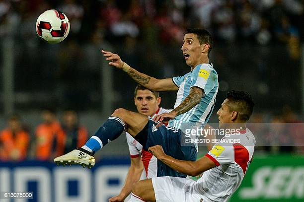 Argentina's Angel Di Maria and Peru's forward Raul Ruidiaz vie for the ball during their Russia 2018 World Cup football qualifier match in Lima on...