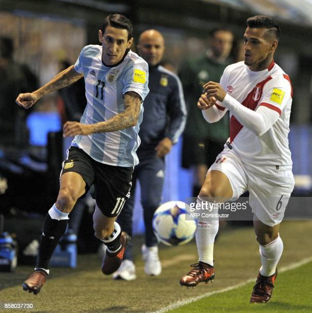 Argentina's Angel Di Maria and Peru's Miguel Trauco vie for the ball during their 2018 World Cup qualifier football match in Buenos Aires on October...