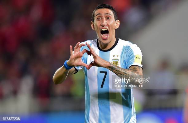 Argentina's Angel Di Maria celebrates after scoring against Chile during their Russia 2018 FIFA World Cup South American Qualifiers' football match...