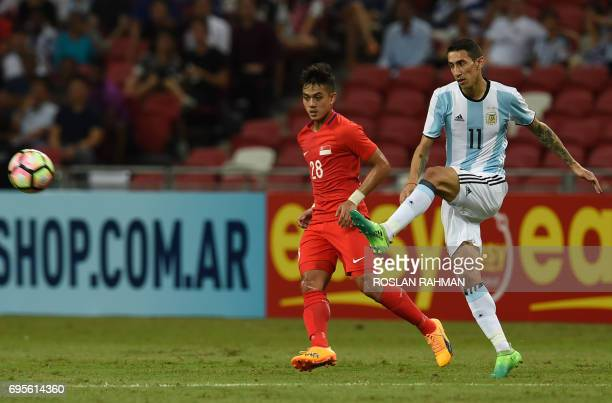 Argentina's Angel Di Maria controls the ball during the international friendly football match between Singapore and Argentina at the national stadium...