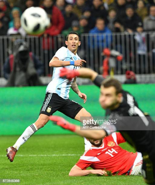 Argentina's Angel Di Maria in action against Russia's goalkeeper Igor Akinfeev during an international friendly football match between Russia and...