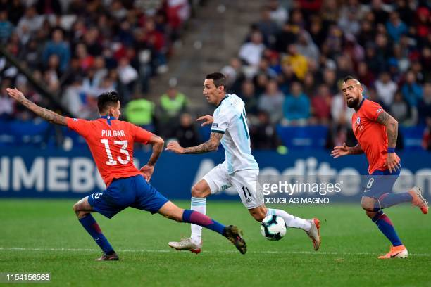 Argentina's Angel Di Maria is marked by Chile's Erick Pulgar during their Copa America football tournament thirdplace match at the Corinthians Arena...