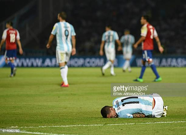 TOPSHOT Argentina's Angel Di Maria lies on the field during a Russia 2018 World Cup football qualifier match against Paraguay in Cordoba Argentina on...