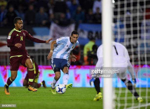 Argentina's Angel Di Maria shoots at Venezuela's goalkeeper Wuilker Farinez during their 2018 World Cup qualifier football match in Buenos Aires on...