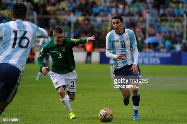 Argentina's Angel Di Maria vies for the ball with Bolivia's Alejandro Chumacero during their 2018 FIFA World Cup qualifier football match in La Paz...