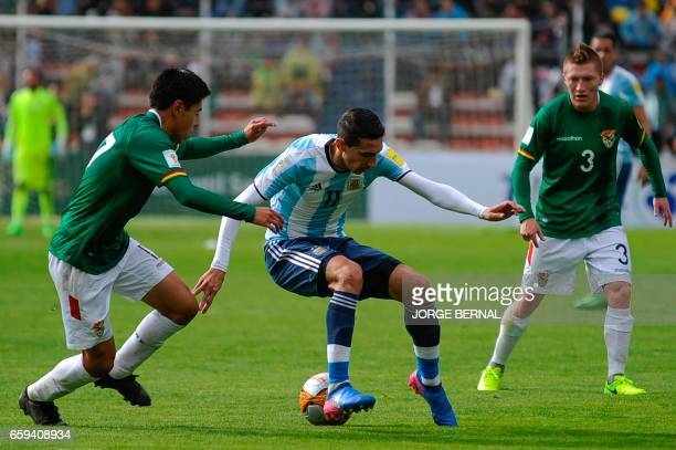 Argentina's Angel Di Maria vies for the ball with Bolivia's Diego Wayar and Bolivia's Alejandro Chumacero during their 2018 FIFA World Cup qualifier...