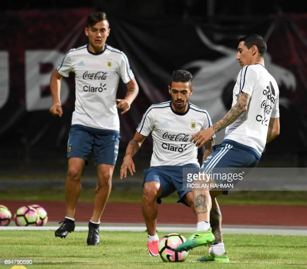 Argentina's Angel Fabian Dimaria and teammates train at Bishan stadium in Singapore on June 11 2017 Argentina will play against Singapore in an...