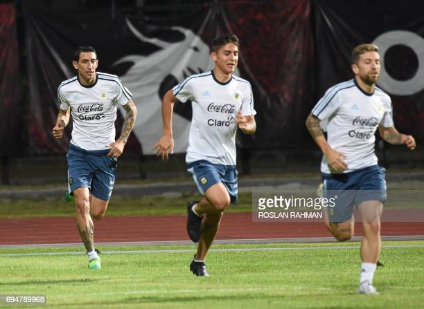 Argentina's Angel Fabian Dimaria and teammates warm up during a training session at Bishan stadium in Singapore on June 11 2017 Argentina will play...
