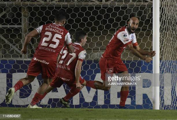 Argentina's Argentinos Juniors defender Carlos Quintana celebrates after scoring against Colombia's Deportes Tolima during their Copa Sudamericana...