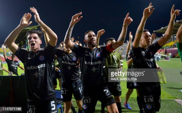 Argentina's Argentinos Juniors football team players celebrate at the end of their Copa Sudamericana football match against Colombia's Deportes...