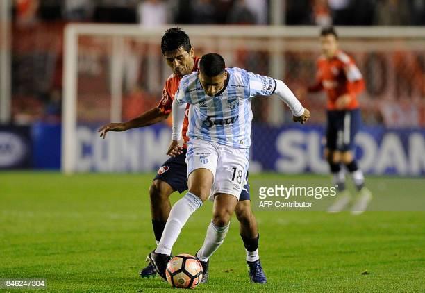 Argentina's Atletico Tucuman midfielder Rodrigo Aliendro vies for the ball with Argentina's Independiente midfielder Walter Erviti during the Copa...