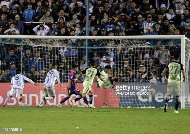 Argentina's Atletico Tucuman player Guillermo Acosta scores a goal against Colombia's Atletico Nacional during the Copa Libertadores 2018 football...