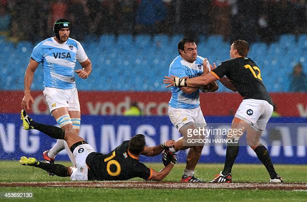 Argentina's Augustin Creevy fights for the ball with South African players Handre Pollard and Juan de Villiers during a Rugby Championship Test match...