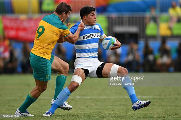 Argentina's Axel Muller is tackled by Australia's Ed Jenkins in the mens rugby sevens match between Argentina and Australia during the Rio 2016...