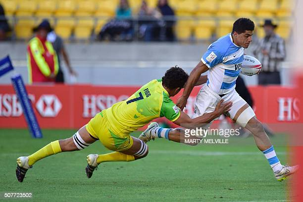Argentina's Axel Muller is tackled by Australia's Sam Figg during the plate final on the second day of the Wellington Sevens rugby Union tournament...