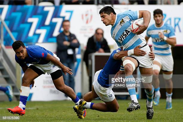 Argentina's Axel Muller is tackled during the HSBC Paris Sevens Series semifinal rugby match between Argentina and Samoa at the Stade Jean Bouin on...