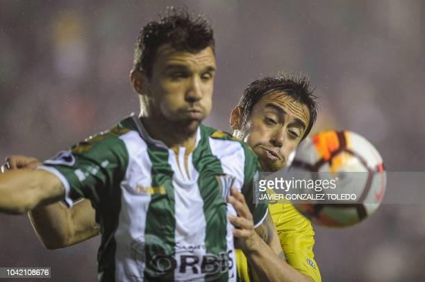 Argentina's Banfield midfielder Nicolas Bertolo vies for the ball with Argentina's Defensa y Justicia forward Nicolas Fernandez during their Copa...