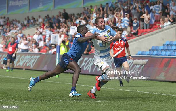 Argentina's Bautista Stavile breaks clear to score his sides second try despite the attentions of France's Gabriel Ngandebe during the 2016 U20 World...