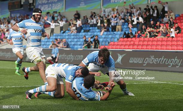 Argentina's Bautista Stavile celebrates scoring his sides second try with teammates Teo Castiglioni and Mariano Romanini during the 2016 U20 World...