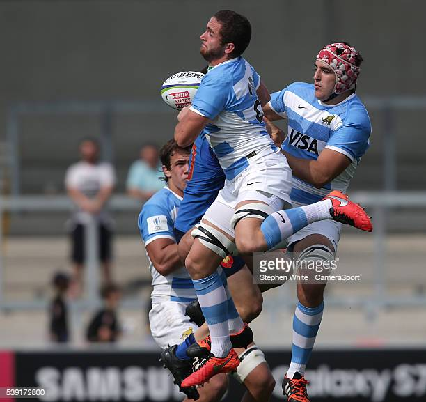 Argentina's Bautista Stavile collects a high ball under pressure from France's Anthony Belleau during the 2016 U20 World Rugby Championships Pool C...