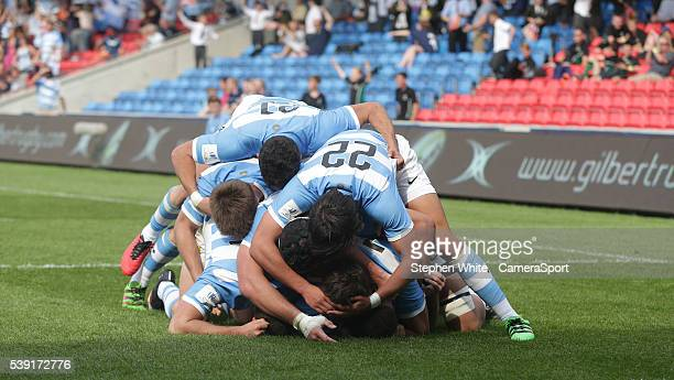 Argentina's Bautista Stavile is swamped by his teammates as he celebrates scoring his sides second try during the 2016 U20 World Rugby Championships...