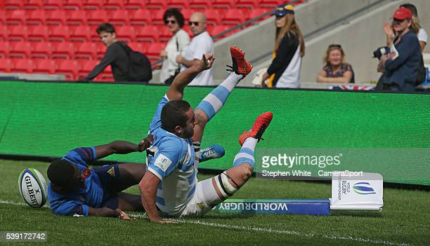 Argentina's Bautista Stavile scores his sides second try despite the attentions of France's Gabriel Ngandebe during the 2016 U20 World Rugby...