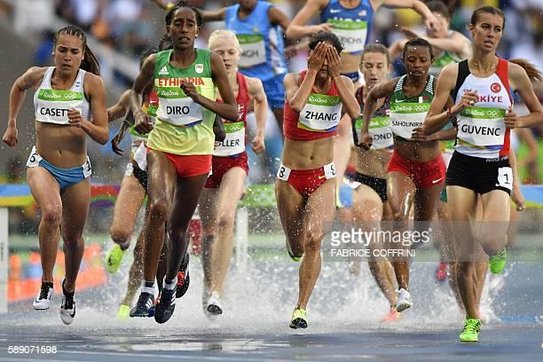TOPSHOT Argentina's Belen Casetta Ethiopia's Etenesh Diro China's Zhang Xinyan and Turkey's Tugba Guvenc compete in the Women's 3000m Steeplechase...