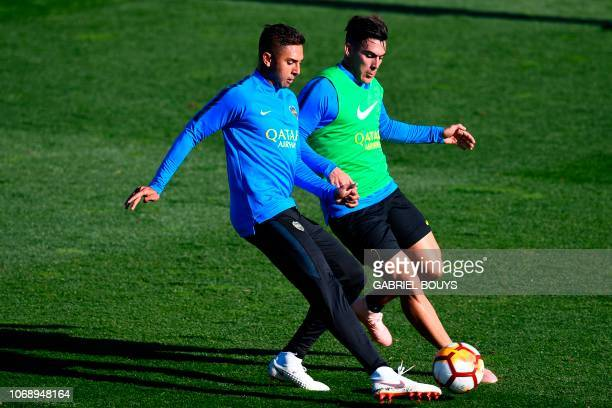Argentina's Boca Juniors Agustin Almendra vies with Argentina's Boca Juniors Cristian Pavon during a training session at the Spanish Football...