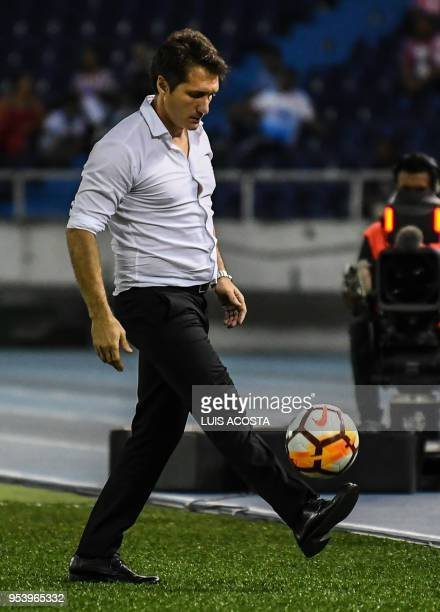 Argentina's Boca Juniors coach Guillermo Barros Schelotto gestures during their 2018 Copa Libertadores football match against Colombia's Junior at...