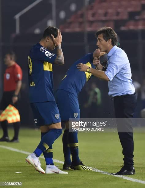Argentina's Boca Juniors coach Guillermo Barros Schelotto gestures next to his players during a Copa Libertadores 2018 football match against...
