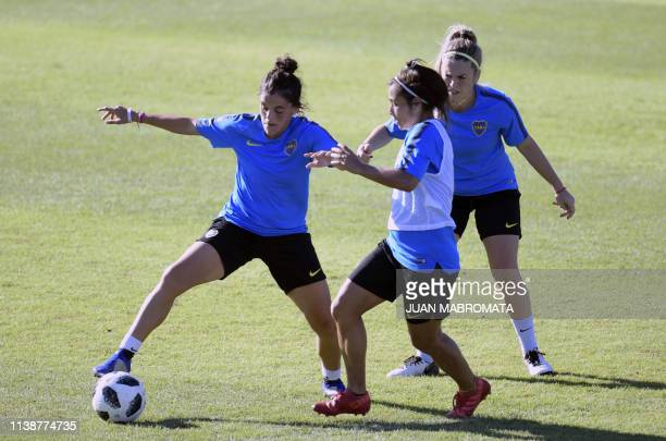 Argentina's Boca Juniors defender Florencia Quinones vies for the ball with Fabiana Vallejos next to midfielder Camila Gomez during a training...