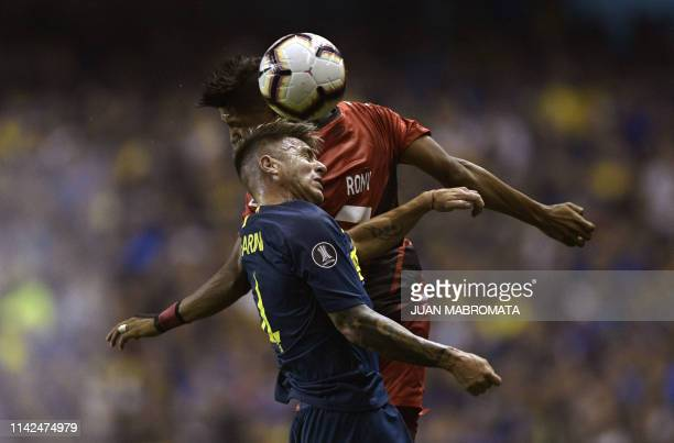 TOPSHOT Argentina's Boca Juniors defender Julio Buffarini vies for the ball with Brazil's Athletico Paranaense forward Rony during their Copa...