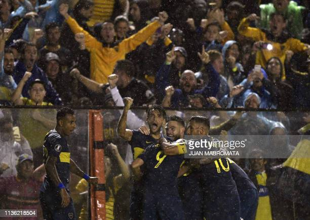 Argentina's Boca Juniors footballers celebrate after midfielder Emanuel Reynoso scored a goal against Bolivia's Wilstermann during the Copa...