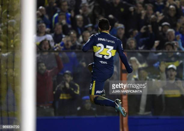 Argentina's Boca Juniors forward Carlos Tevez celebrates after scoring the team's fifth goal against Peru's Alianza Lima during the Copa Libertadores...