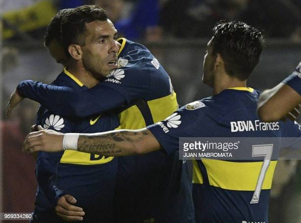 Argentina's Boca Juniors forward Carlos Tevez celebrates with teammates after scoring the team's fifth goal against Peru's Alianza Lima during the...
