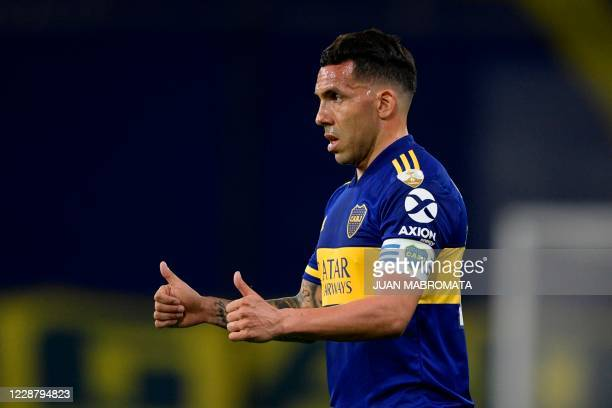 Argentina's Boca Juniors forward Carlos Tevez gives his thumbs up during their closed-door Copa Libertadores group phase football match at the La...